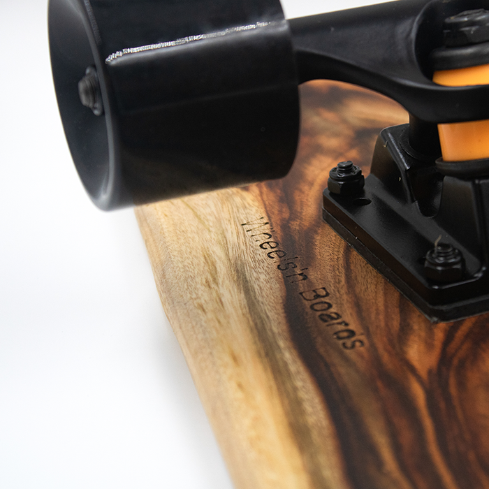 Zoom on the black wheels of a longboard